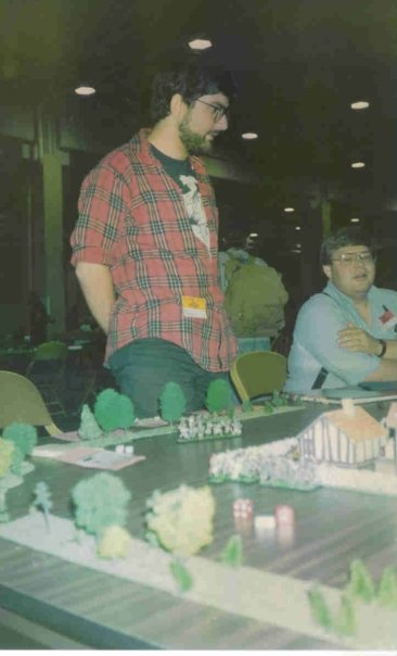Here I am playing a minis game at GenCon, 1990.